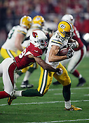 Arizona Cardinals cornerback Justin Bethel (28) tackles Green Bay Packers wide receiver Jeff Janis (83) after a 6 yard second quarter pass reception good for a first down at the Arizona Cardinals 24 yard line during the NFL NFC Divisional round playoff football game against the Arizona Cardinals on Saturday, Jan. 16, 2016 in Glendale, Ariz. The Cardinals won the game in overtime 26-20. (©Paul Anthony Spinelli)