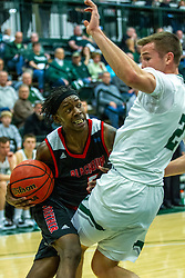 BLOOMINGTON, IL - November 12: Chanz Aldridge pushes in on defender Peter Lambesis during a college basketball game between the IWU Titans  and the Blackburn Beavers on November 12 2019 at Shirk Center in Bloomington, IL. (Photo by Alan Look)