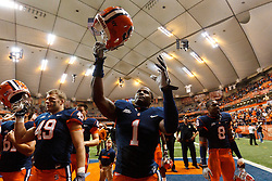 Oct 21, 2011; Syracuse NY, USA;  Syracuse Orange safety Phillip Thomas (1) celebrates with teammates after the game against the West Virginia Mountaineers at the Carrier Dome.  Syracuse defeated West Virginia 49-23. Mandatory Credit: Jason O. Watson-US PRESSWIRE