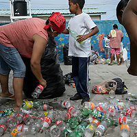 Mesoamerican reef. Rock Cay ,Utila, Honduras.Residents of Rocks Cay collect plastic trash at sea as part of a campaign promoted by the local school. The plastic material collected is exchanged for points that are later exchanged for new clothes. The accumulation of plastic waste from unsustainable patterns of production and consumption are everywhere, even at the bottom of the sea on an island that lives off tourism and marine resources.