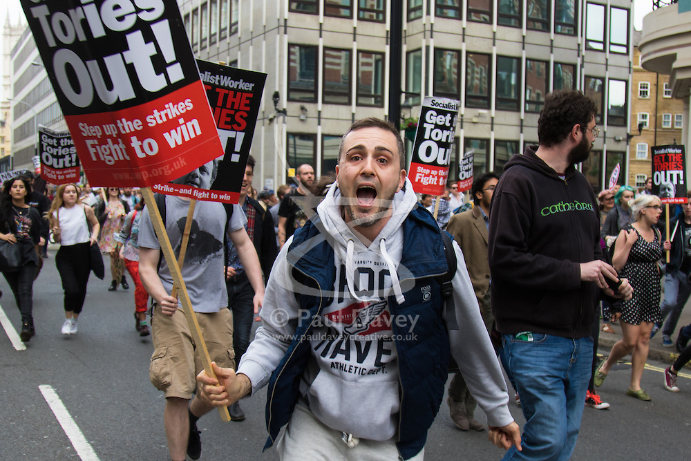London, May 27th 2015. Anti-austerity protesters rush down Victoria street from Parliament square in what seemed to be a rather directionless march