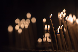 """3 June 2018, Novi Sad, Serbia: Candles lit in anticipation of Sunday service in the Eastern Orthodox Cathedral Church of the Holy Great Martyr George. On 31 May - 6 June 2018, in Novi Sad, Serbia, the Serbian Orthodox Church stood as one of the host churches of the Conference of European Churches General Assembly. More than 400 delegates, advisors, stewards, youth, staff, and distinguished guests took part in the Assembly and related events, gathered under the theme, """"You shall be my witnesses""""."""