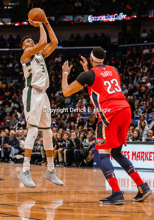 Dec 13, 2017; New Orleans, LA, USA; Milwaukee Bucks forward Giannis Antetokounmpo (34) shoots over New Orleans Pelicans forward Anthony Davis (23) during the first quarter at the Smoothie King Center. Mandatory Credit: Derick E. Hingle-USA TODAY Sports