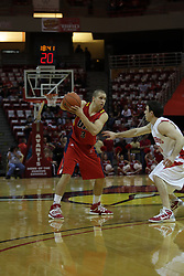 11 December 2010: Robo Kreps plays kee away from Alex Rubin during an NCAA basketball game between the Illinois - Chicago Flames (UIC) and the Illinois State Redbirds (ISU) at Redbird Arena in Normal Illinois.
