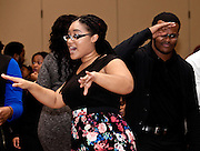 """Angelique Redd, left, and Nycholas Partee dance to the sounds of DJ """"Superstar Smit"""" at the All Black Affair at Baker Center Ballroom  at Ohio University on Friday, January 29, 2016. © Ohio University / Photo by Sonja Y. Foster"""