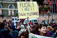 """A supporter of LGBT associations holds a placard reading """"Out of the priests from his underwear"""".<br /> Rally in central Rome of LGBT associations, for call for more rights for homosexual couples, the protest  after approval of the bill on civil union  which was approved recently by  the Italian Senate. Rome, Italy 5th March 2016"""