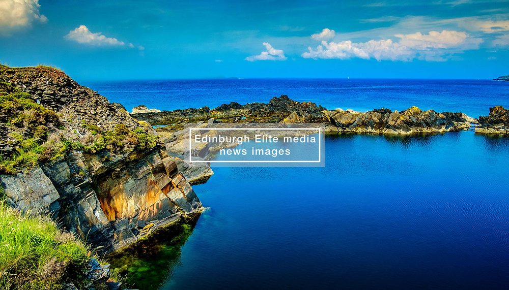 Easdale Island, the smallest permanently-inhabited island of the Inner Hebrides, Scotland.  A flooded slate quarry is all that remains of what was once the centre of the Scottish slate mining industry.<br /> <br /> (c) Andrew Wilson   Edinburgh Elite media