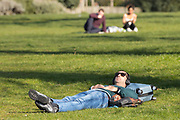 UNITED KINGDOM, London: 26 February 2019. A man soaks up some sunshine in Kensington Gardens on what is set to be the warmest day in February since records began. Temperatures are set to reach up to 20 degrees Celsius in the capital today. Rick Findler / Story Picture Agency