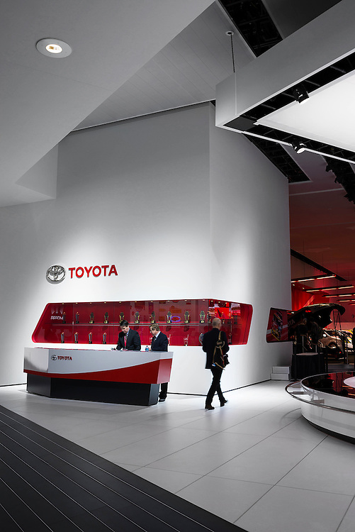 Toyota and other automotive brands invest heavily in convention booth design. Here, myriad angles and flat surfaces guide visitors toward the displays of Toyota's newest products.