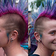 Portrait of Dyke/FTM with purple Mohawk with pink tail. She has both ear and facial piercings. I ask her how she would describe herself? Her reply was, Dyke/FTM (female to male), Gender Queer, Tranny Boy.<br />