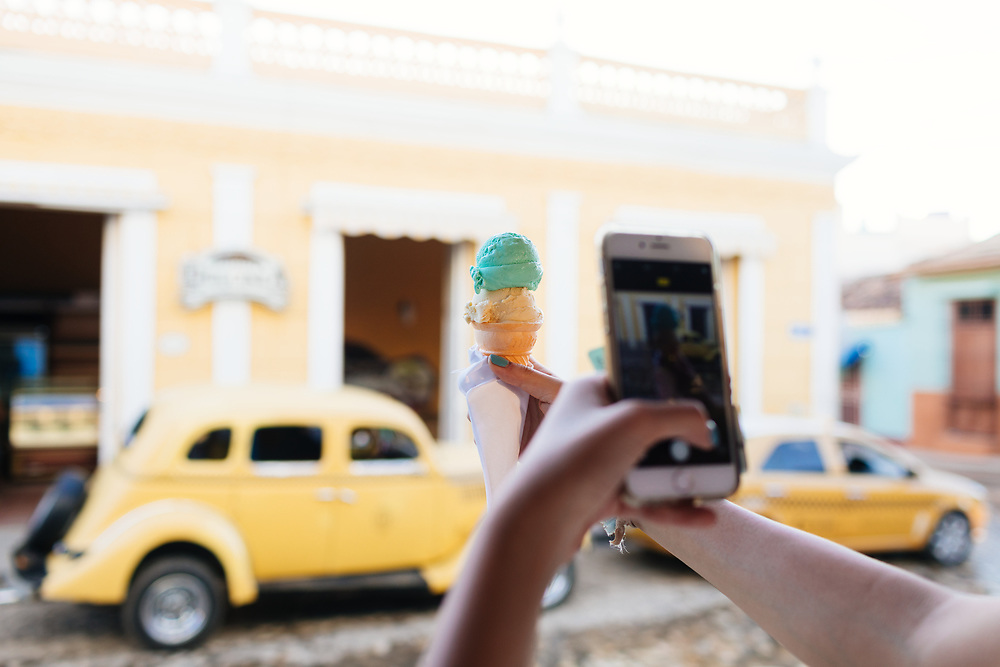 25 year old girl takes photo of ice cream in Trinidad, Cuba