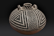 Small pottery canteen with narrow neck, loop handles for attaching straps and a geometric black on white design, from Mesa Verde, 1180-1230 AD, Pueblo III period, from the Anasazi Heritage Centre, Dolores, Colorado, USA.  This canteen may have served a ritual purpose. Picture by Manuel Cohen
