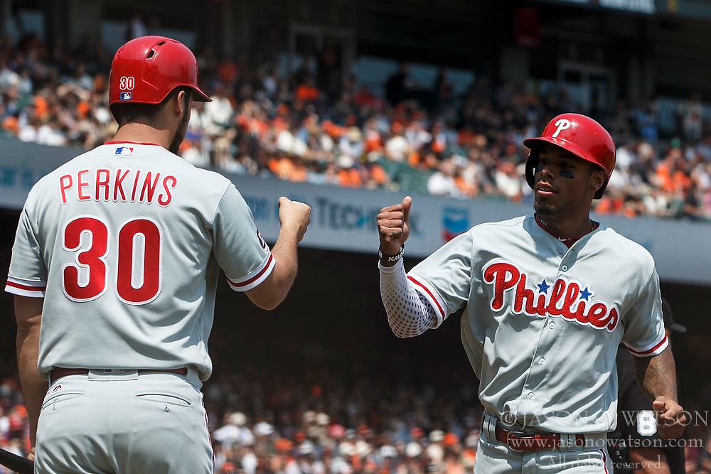 SAN FRANCISCO, CA - AUGUST 20: Nick Williams #5 of the Philadelphia Phillies is congratulated by Cameron Perkins #30 after scoring a run against the San Francisco Giants during the second inning at AT&T Park on August 20, 2017 in San Francisco, California. The Philadelphia Phillies defeated the San Francisco Giants 5-2. (Photo by Jason O. Watson/Getty Images) *** Local Caption *** Nick Williams; Cameron Perkins