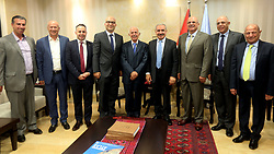 May 25, 2019 - Ramallah, West Bank, Palestinian Territory - Palestinian Prime Minister Mohammad Ishtayeh meets with a delegation of businessmen from Jerusalem in the West Bank city of Ramallah, on May 25, 2019  (Credit Image: © Prime Minister Office/APA Images via ZUMA Wire)