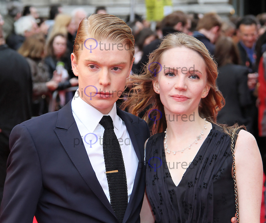 LONDON - APRIL 15:  Freddie Fox; Tamzin Merchant attend The Olivier Awards 2012 at the Royal Opera House, Covent Garden, London, UK. April 15, 2012. (Photo by Richard Goldschmidt)