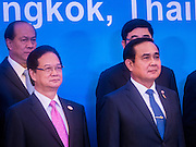 23 JULY 2015 - BANGKOK, THAILAND: NGUYEN TAN DUNG (left), Prime Minister of Vietnam,  and PRAYUTH CHAN-O-CHA, Prime Minister of Thailand, (right) stand with other members of their countries' delegations at Government House in Bangkok. The Vietnamese Prime Minister and his wife came to Bangkok for the 3rd Thailand - Vietnam Joint Cabinet Retreat. The Thai and Vietnamese Prime Minister discussed issues of mutual interest.      PHOTO BY JACK KURTZ