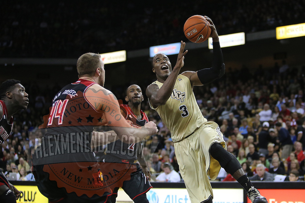 UCF Knights guard Isaiah Sykes (3) drives to the basket during an NCAA basketball game between the 14th ranked Louisville Cardinals and the UCF Knights at the CFE Arena on Tuesday, December 31, 2013 in Orlando, Florida. (AP Photo/Alex Menendez)