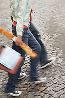 Couple walking carrying baguette and bags low section