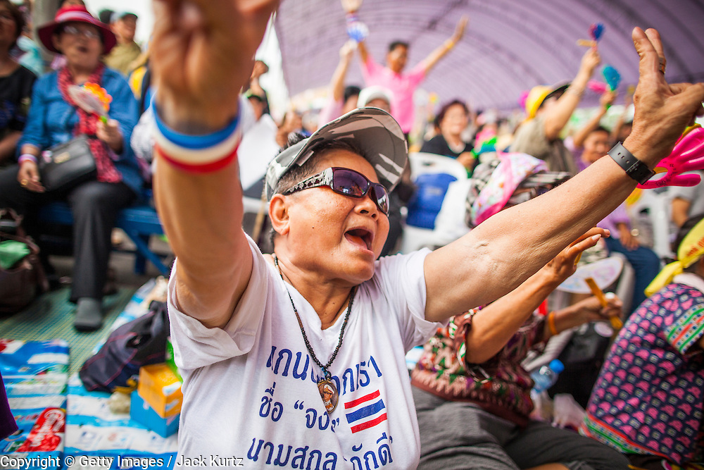 "24 NOVEMBER 2012 - BANGKOK, THAILAND: A woman cheers for Gen Boonlert ""Seh Ai"" Kaewprasit, leader of Pritak Siam and organizer of the anti-government rally during a large anti government, pro-monarchy, protest  on November 24, 2012 in Bangkok, Thailand. The Siam Pitak group, which sponsored the protest, cited alleged government corruption and anti-monarchist elements within the ruling party as grounds for the protest. Police used tear gas and baton charges againt protesters.       PHOTO BY JACK KURTZ"