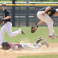 Laura Stoecker/lstoecker@dailyherald.com<br /> Jacobs' Matt Kozlak leaps to avoid a collision with Prairie Ridge's John Myers as he slides safely into second base in the fifth inning of the Class 4A McHenry sectional championship at Peterson Park in McHenry on Saturday, June 7.