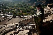 Specialist Tyler Jones looks out over the Tangi Valley from mountain-top observation post.