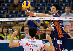 Matevz Kamnik of ACH vs Emanuele Birarelli of Trentino at 2nd Semifinal match of CEV Indesit Champions League FINAL FOUR tournament between ACH Volley, Bled, SLO and Trentino BetClic Volley, ITA, on May 1, 2010, at Arena Atlas, Lodz, Poland. (Photo by Vid Ponikvar / Sportida)