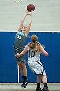 South Burlington's Emma MacDonough (33) leaps to grab the rebound during the girls basketball game between the South Burlington Rebels and the Burlington Sea Horses at Burlington High School on Tuesday night Febraury 2, 2016 in Burlington. (BRIAN JENKINS/for the FREE PRESS)