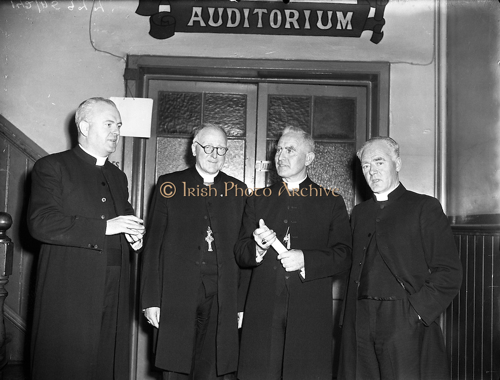 "Most Reverend Dr Bishop Lucey of Cork delivers a lecture in Fr Matthew Hall for Centenary.10/10/1956..Cornelius ""Con"" Lucey (1902–82) was a Roman Catholic Bishop of Cork and Ross...Cornelius Lucey was born into a farming family at Carrigrohane, near Cork City. He studied at St Finbarr's College, Farranferris, the diocesan college. He graduated from St Patrick's College, Maynooth with BC and BCL, and obtained MAs at Innsbruck University in 1927–29 and then University College Dublin...Lucey was ordained a priest in 1927. He held the Chair of Philosophy and Political Theory at St. Patrick's College, Maynooth, from 1929 to 1950. He was one of the founders of Christus Rex, a priest's society devoted to social issues, on which he was a prominent commentator. In 1951 he was appointed bishop of the diocese of Cork, from 1958 united to the Diocese of Ross. He founded the St. Anne's Adoption Society in 1954. His outspoken sermons, often given at confirmations, made him something of a thorn in the side of the establishment. His views on matters of faith and morals were conservative, and he was involved in a controversy in the 1960s, when he withdrew the diocesan faculties of Father James Good, a lecturer at University College, Cork, for publicly dissenting from the teaching of Pope Paul VI. He started the Cork diocesan mission to Peru, and many priests from Cork ministered there from 1961...Lucey retired as bishop in 1980, in the early stages of leukemia. He went to the Turkana District in Kenya to work as an ordinary curate with Good, who had gone there some years earlier....After nearly two years in Kenya he became seriously ill. He was flown back to Cork in September 1982 and died within days...In 1985, as part of the Cork 800 festival, a site between Grand Parade and South Main Street was developed into an urban park named ""Bishop Lucey Park"".."