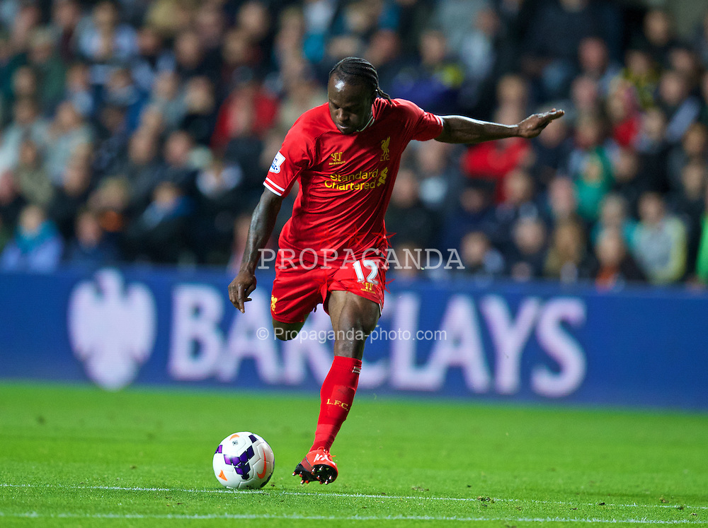 SWANSEA, WALES - Monday, September 16, 2013: Liverpool's Victor Moses scores the second goal against Swansea City, on his debut, during the Premiership match at the Liberty Stadium. (Pic by David Rawcliffe/Propaganda)