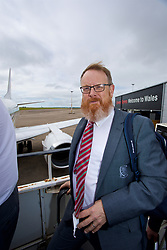 CARDIFF, WALES - Monday, September 4, 2017: Wales' head of international affairs Mark Evans boards the team plane as the squad depart Cardiff Airport to travel to Chișinău ahead of the 2018 FIFA World Cup Qualifying Group D match against Moldova. (Pic by David Rawcliffe/Propaganda)