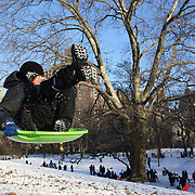 Padeas Robin, 7, from New York goes airborne while sledding in Central Park after New York City was hit with over 7 inches of snow during its first winter storm of the year. Central Park, Manhattan, New York, USA. 4th January 2014 Photo Tim Clayton