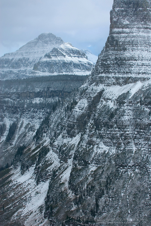Fresh autumn snow highlighting the sedimentary layers in the mountains of Glacier National Park Montana, from Going to the Sun Road.