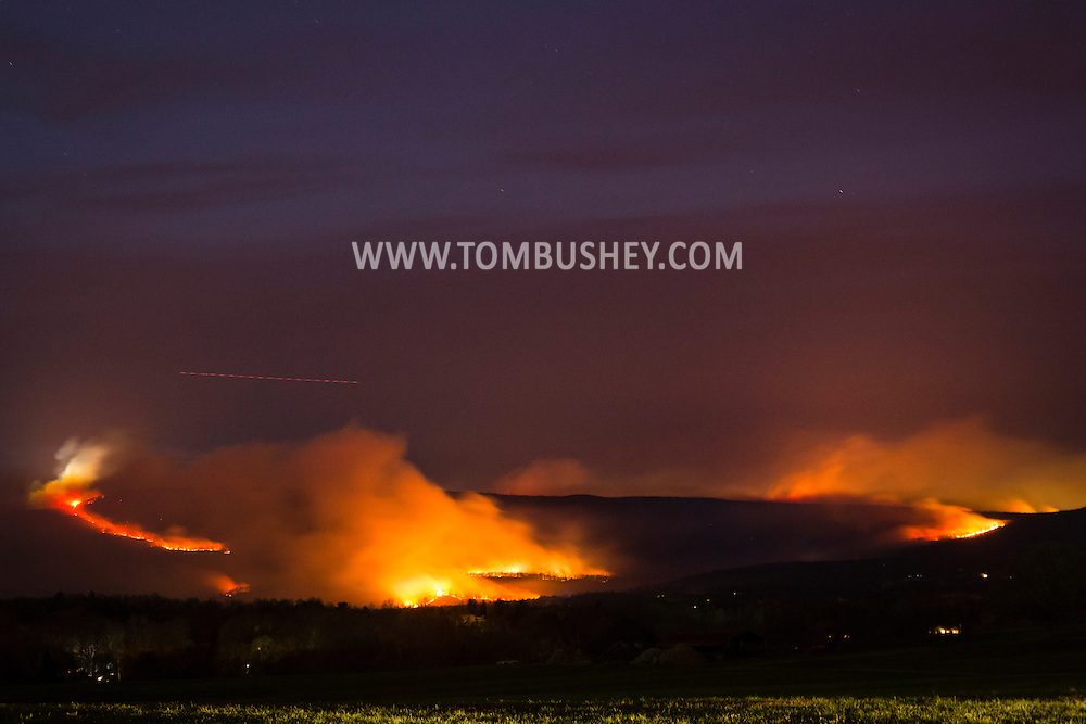 Pine Bush, New York - Smoke and flames from a brush fire at Sam's Point Preserve on the Shawangunk Ridge are visible in a view from Pine Bush on April 25, 2016. The fire started on April 23 and has burned more than 2,000 acres.