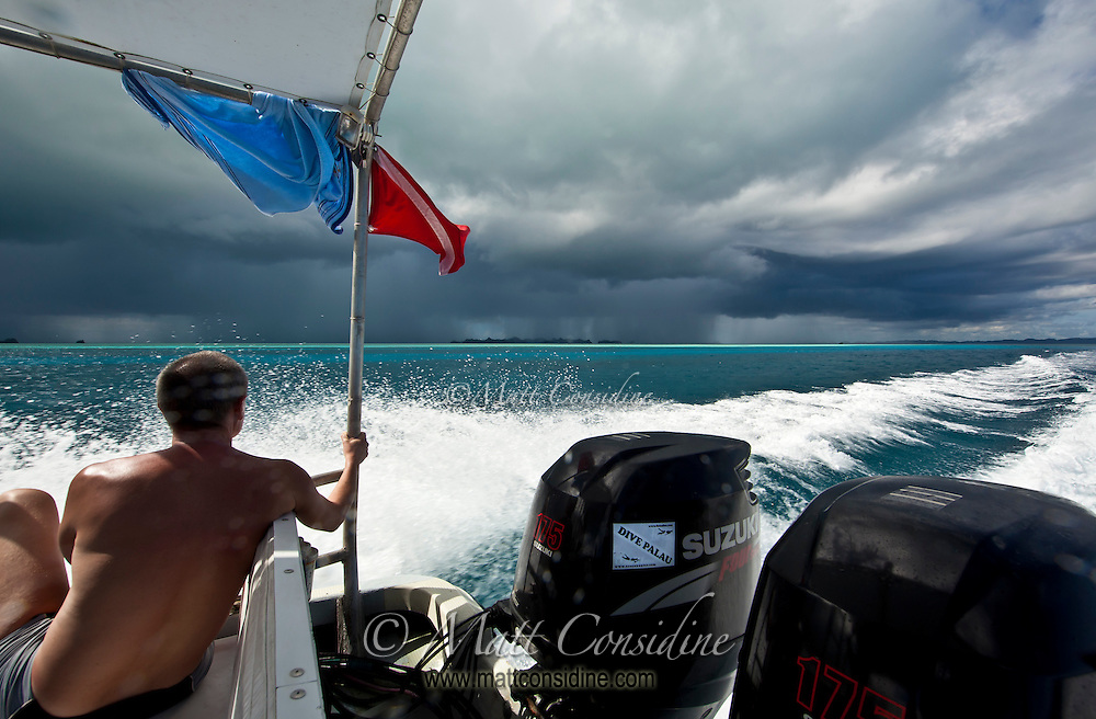 The tropical storm is a spectacle underlined by the bright aqua blue of the shallow tropical water, Palau Micronesia. (Photo by Matt Considine - Images of Asia Collection)