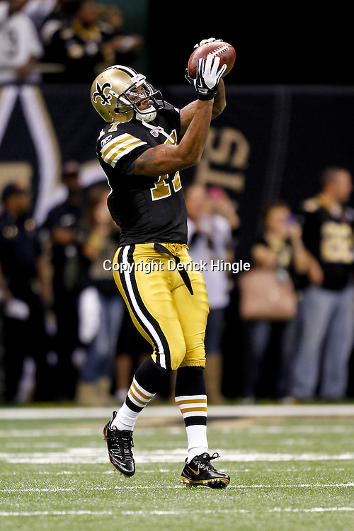 November 6, 2011; New Orleans, LA, USA; New Orleans Saints wide receiver Robert Meachem (17) prior to kickoff of a game against the Tampa Bay Buccaneers at the Mercedes-Benz Superdome. Mandatory Credit: Derick E. Hingle-US PRESSWIRE
