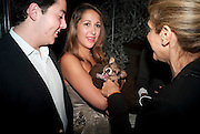 ALEXANDER MASRI; CHARLOTTE MASRI; DOG; LOUIS, Drinks soiree and silent auction of Ô100 ThingsÕ,  hosted by the Mayor of London Boris Johnson, in aid of the Legacy List. 50 St. James. London. 2 November 2011. <br /> <br />  , -DO NOT ARCHIVE-© Copyright Photograph by Dafydd Jones. 248 Clapham Rd. London SW9 0PZ. Tel 0207 820 0771. www.dafjones.com.<br /> ALEXANDER MASRI; CHARLOTTE MASRI; DOG; LOUIS, Drinks soiree and silent auction of '100 Things',  hosted by the Mayor of London Boris Johnson, in aid of the Legacy List. 50 St. James. London. 2 November 2011. <br /> <br />  , -DO NOT ARCHIVE-© Copyright Photograph by Dafydd Jones. 248 Clapham Rd. London SW9 0PZ. Tel 0207 820 0771. www.dafjones.com.