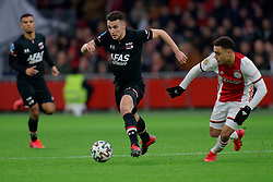 Oussama Idrissi #11 of AZ Alkmaar, Sergino Dest #28 of Ajax in action during the Dutch Eredivisie match round 25 between Ajax Amsterdam and AZ Alkmaar at the Johan Cruijff Arena on March 01, 2020 in Amsterdam, Netherlands