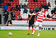 Barnet's Bondz N'Gala wins a free kick for Barnet during the EFL Sky Bet League 2 match between Doncaster Rovers and Barnet at the Keepmoat Stadium, Doncaster, England on 8 October 2016. Photo by Richard Holmes.