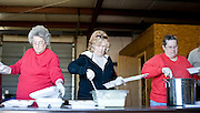 Seaboard Lions Club members' wives help serve up the BBQ lunch fundraiser.