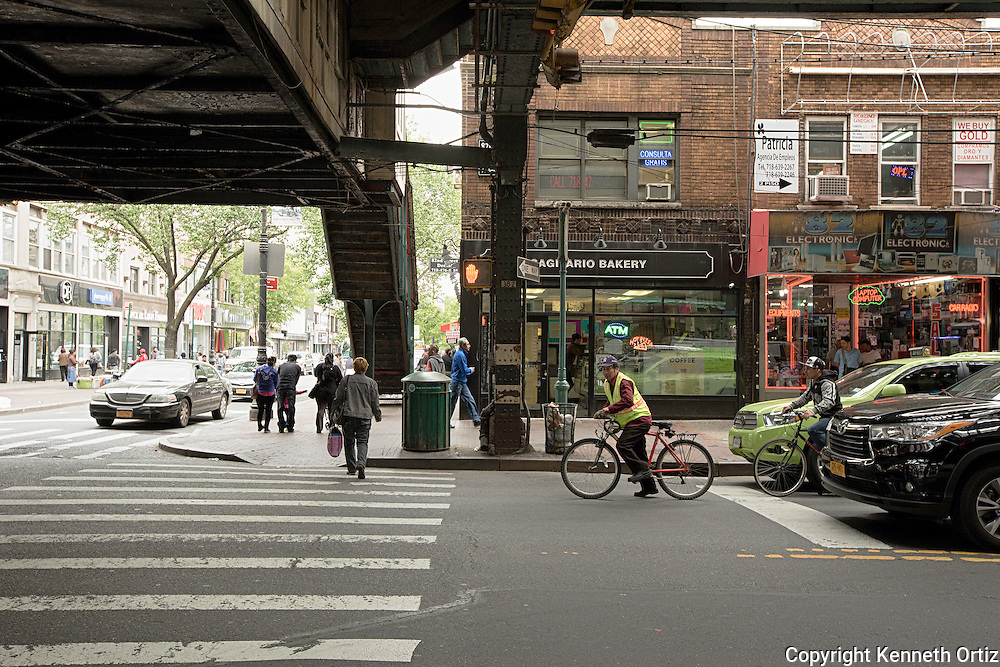 A shot of people on 82nd Street  and Roosevelt Avenue in Jackson Heights Queens.