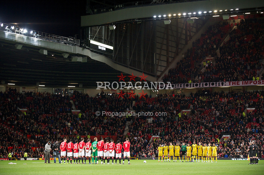 MANCHESTER, ENGLAND - Wednesday, November 29, 2011: Crystal Palace players, including Welsh international goalkeeper Lewis Price, stand to applaud Wales manager Gary Speed who died earlier this week, before the Football League Cup Quarter-Final match at Old Trafford. (Pic by David Rawcliffe/Propaganda)