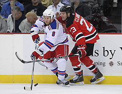 Nov 5, 2010; Newark, NJ, USA;  New Jersey Devils center David Clarkson (23) defends against New York Rangers right wing Brandon Prust (8) during the second period at the Prudential Center.