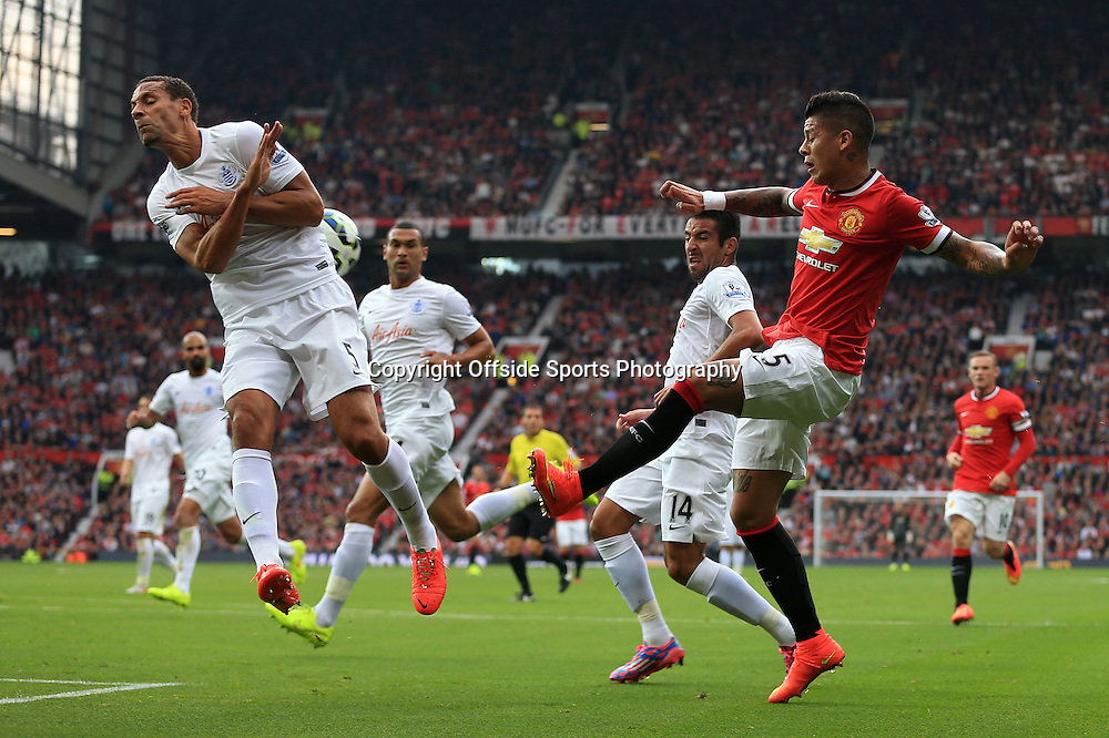 14th September 2014 - Barclays Premier League - Manchester United v Queens Park Rangers - Rio Ferdinand of QPR closes down Marcos Rojo of Man Utd - Photo: Simon Stacpoole / Offside.