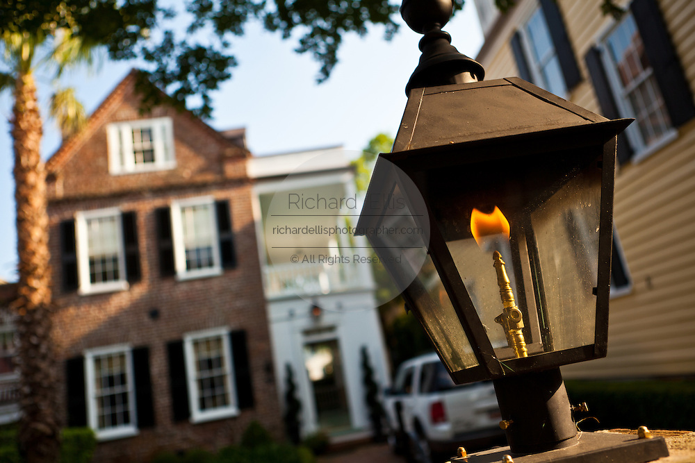 Gas lantern outside a historic Charleston Single style home in Charleston, SC.