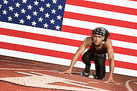 Runner on a track in starting block