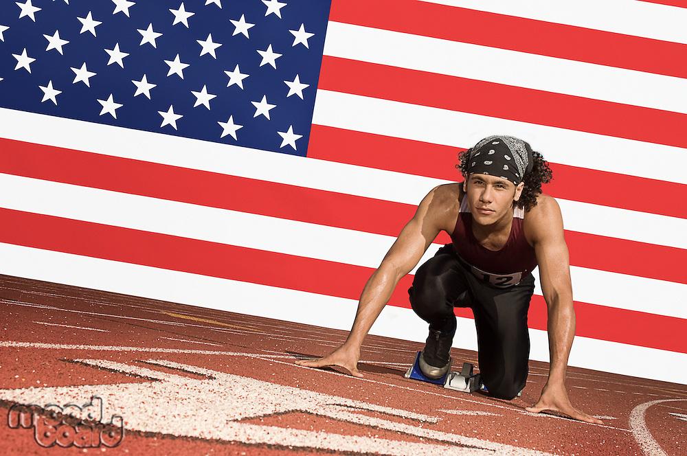 Runner on a track in starting block