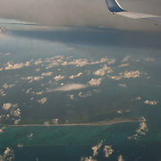 Aerial view of Playa Mujeres from Airplane Window.