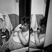 Hughie MacInnis seen shaving in the mirror before attending church, Sudbury, Ontario. From the book Cage Call: Life and Death in the Hard Rock Mining Belt. An in-depth project spanning over 12-years examining communities in one of the richest mining regions in the world located in Northwestern Ontario and Northeastern Quebec in Canada.