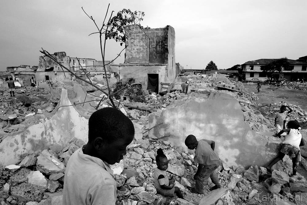Children play at former military barracks, which were demolished in early 2008, in Monrovia, Liberia, May 9, 2008. The Liberian military force was demobilized in 2005 and, since then, the U.S. has overseen the reform of the country's security sector but initial plans to train a new 4000-strong force to take over from U.N. peacekeepers has been delayed and scaled down to half the original size. .