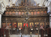 Carved wooden iconostasis with painted icons in the nave of the Church of Labova e Kryqit, or church of the Holy Cross, dedicated to St Mary, one of the oldest churches in Albania, mainly 13th century although with Byzantine foundations of 527-565 AD in the time of Emperor Justinian, Labova e Kryqit, Gjirokastra, Albania. The nave and aisle form a cruciform plan and the high central cupola is typically Byzantine. The interior walls are covered with 9 levels of frescoes. Picture by Manuel Cohen